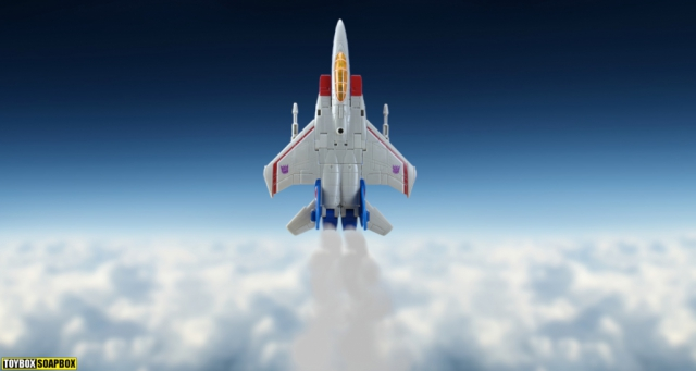 earthrise starscream jet bursting through clouds